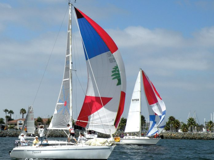 2 colorful boats of the 59 racing in the 8th Annual HospiceCare Benefit Regatta.jpg