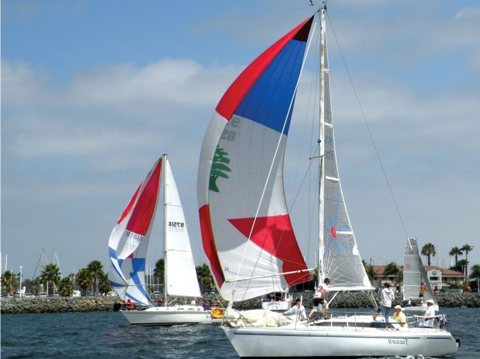 colorful boats of the 59 racing in the 8th Annual HospiceCare Benefit Regatta.jpg