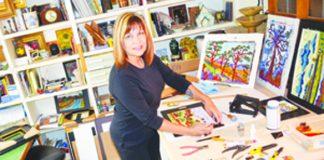 WEBPAINTERIn her La Mesa home office, Monica Straub frames and prepares clients' orders of her paintings..jpg