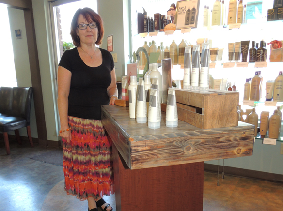 WEBPret-a-Porter, uses organic products in the salon and has had the furniture refaced with polished pallet wood..jpg