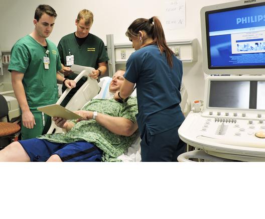 WEBallied health students in hospital days traiining scenario.jpg