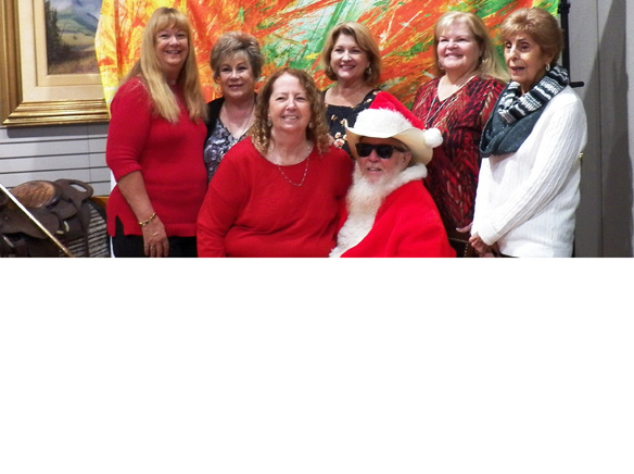 WEBWieghorst Museum Ladies with Cowboy Santa.jpg