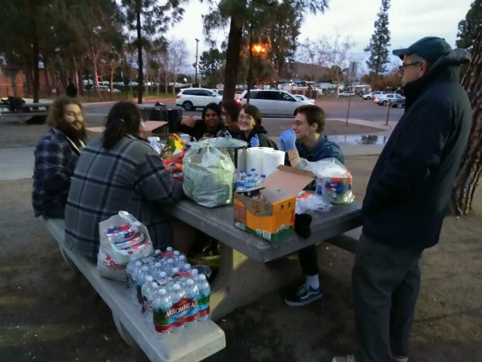Food Not Bombs volunteers providing food and needed items to the homeless 2.jpg